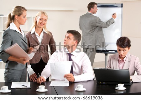 Image of business group discussing new project during break in the office - stock photo