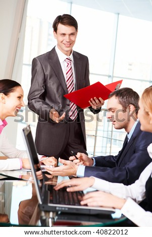 Image of business group discussing new project or plan in the office - stock photo