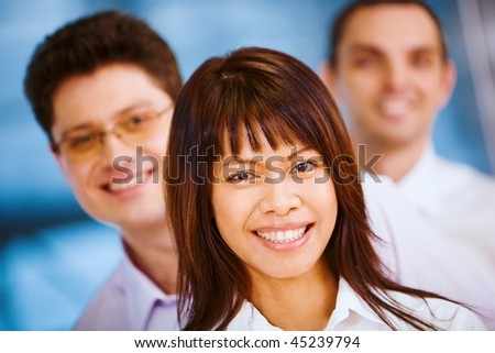 Image of business group standing in line with pretty female in front