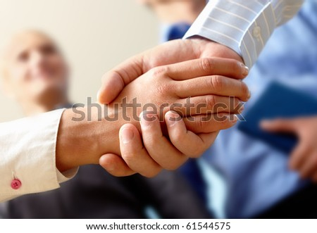 Image of business handshake after making an agreement