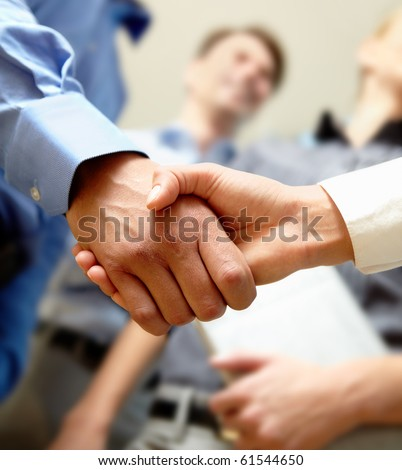 Image of business handshake after signing new contract