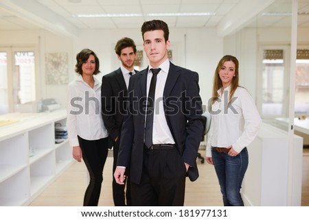 Image of business leader looking at camera in working environment