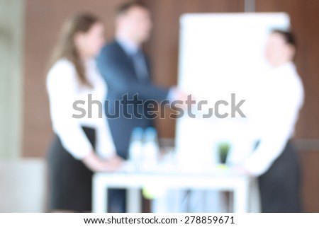 Image of business partners discussing documents and ideas at meeting. blur background with bokeh - stock photo