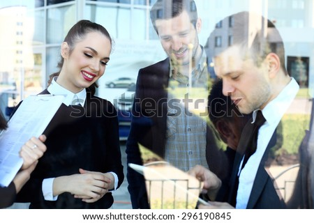 Image of business partners discussing documents and ideas at meeting - double exposure - stock photo