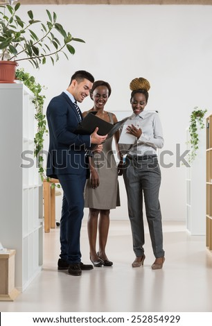 Image of business partners discussing documents and ideas at meeting. Full length portrait - stock photo