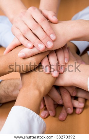 Image of business partners hands on top of each other - stock photo