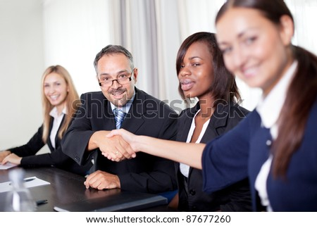 Image of business partners handshake on signing contract - stock photo