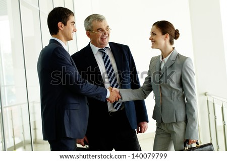 Image of business partners handshaking after striking deal - stock photo