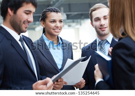 Image of business partners interacting at meeting