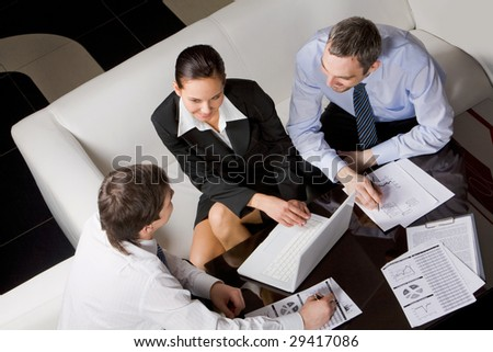 Image of business partners thinking about new project at meeting - stock photo