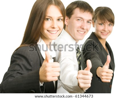 Image of business people giving the thumbs-up sign - stock photo