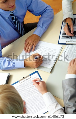 Image of business people hands during work planning at meeting - stock photo
