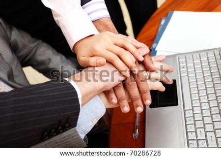 Image of business people hands on top of each other - stock photo