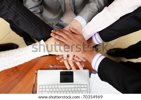 Image of business people hands on top of each other. View from above - stock photo
