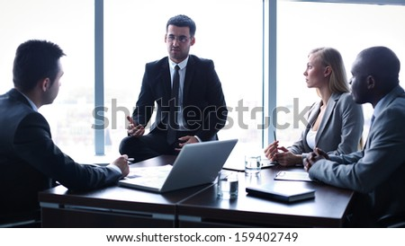 Image of business people interacting at meeting in office - stock photo