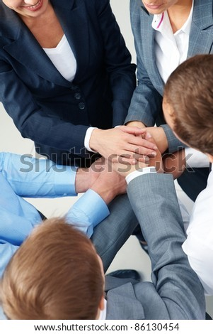 Image of business people keeping their hands in pile symbolizing support and power - stock photo