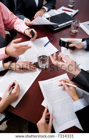 Image of business people's hands at conference - stock photo