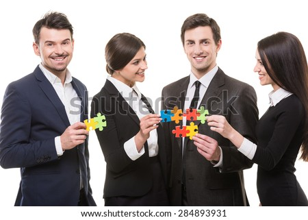 Image of business people wanting to put pieces of puzzle together.
