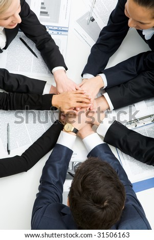 Image of business people with their hands on top of each other symbolizing partnership - stock photo