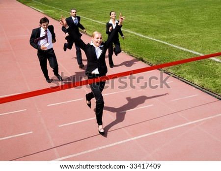 Image of business race with winner in front - stock photo