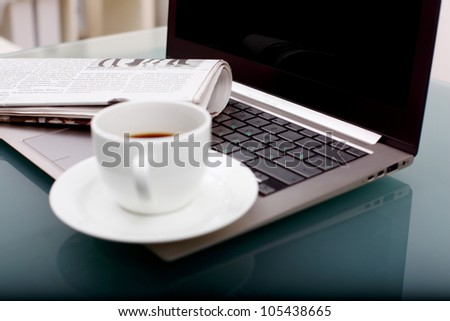 Image of business table with a cup of coffee and norebook - stock photo