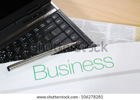 Image of Business table with Newspaper, laptop and pen - stock photo