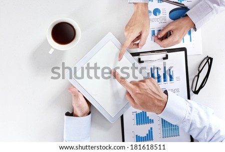 Image of business team at the meeting using tablet touch pad pc - stock photo
