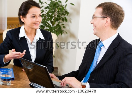 Image of business woman telling about her last work to man at interview - stock photo