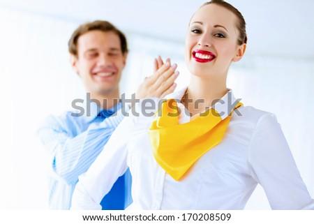 Image of businessman and businesswoman smiling joyfully - stock photo
