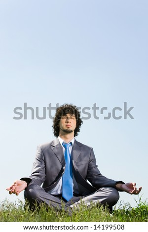 Image of businessman doing yoga in a natural environment - stock photo