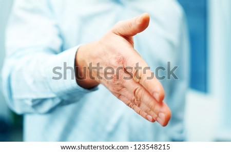 Image of businessman extending hand to shake