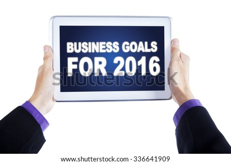Image of businessman hands holding a digital tablet with business goals on the screen, isolated on white background - stock photo