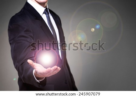Image of businessman having power in hand - stock photo