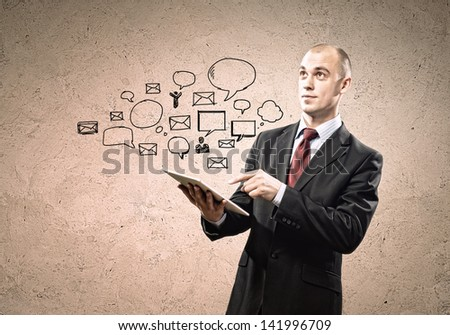 Image of businessman holding ipad in hands - stock photo