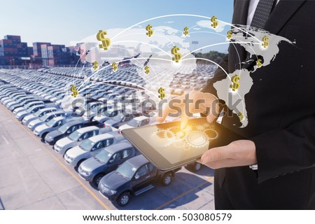 Image of businessman holding tablet ,Finance concept on Global network coverage world map , Logistic Import Export automobile background (Elements of this image furnished by NASA)