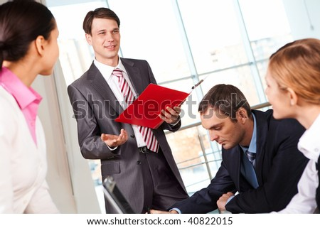 Image of businessman presenting new project or plan to his colleagues - stock photo