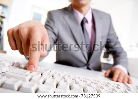 Image of businessman?s finger pressing computer key - stock photo