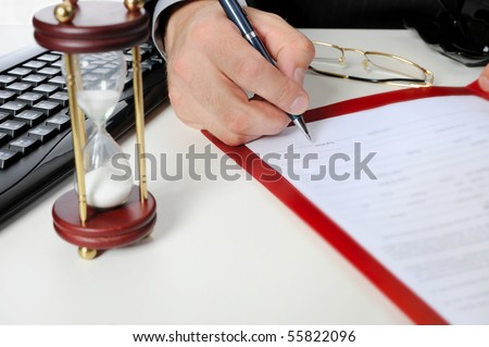 Image of businessman?s hand ready to make signature in a document - stock photo