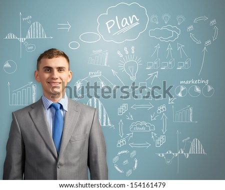 image of businessman thinking about innovation in business, sketch on the wall of charts and diagrams - stock photo