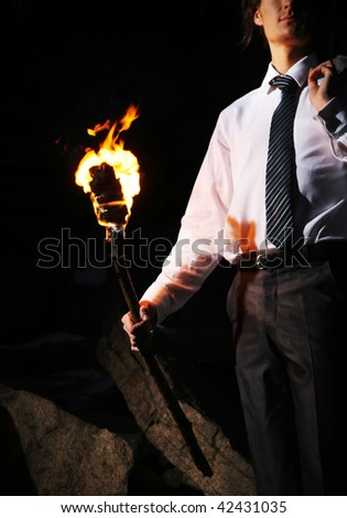 Image of businessman with flame in darkness - stock photo