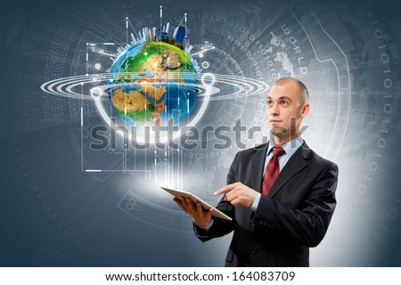 Image of businessman with tablet pc. Elements of this image are furnished by NASA - stock photo