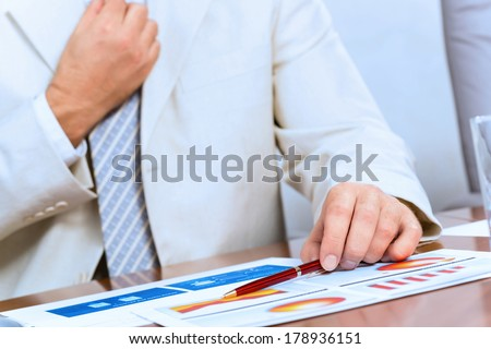 image of businessman without face straightens tie yourself - stock photo