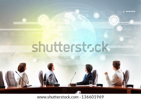 Image of businesspeople at presentation looking at virtual project - stock photo