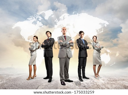 Image of businesspeople standing against world map background