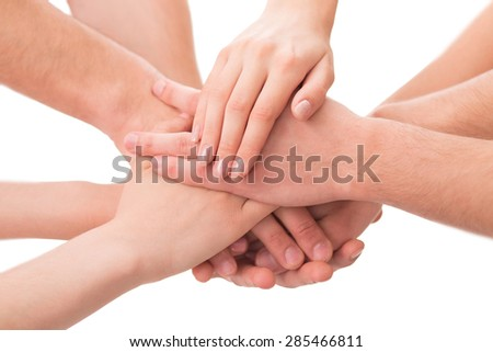 Image of businesspeople symbolizing successful team. Different people holding their hands alltogether isolated on white background. - stock photo