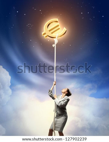 Image of businesswoman climbing the rope attached to euro sign - stock photo