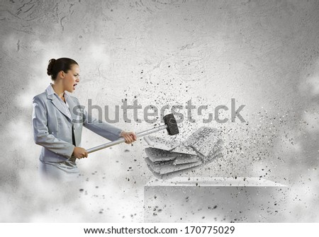 Image of businesswoman crushing with hammer pile of keyboards - stock photo
