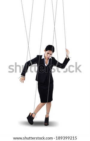 Image of businesswoman hanging on strings like marionette