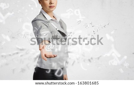 Image of businesswoman holding mail symbol in hand