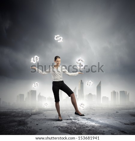 Image of businesswoman juggling with dollar symbols. Currency concept - stock photo